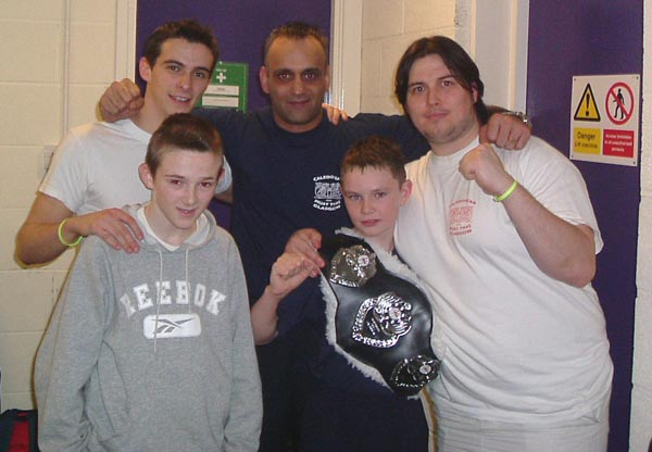 tommy young(corner), brian calder( corner and proud dad), scott smith (pad man), allan mckay (fighter), jordan calder (new north area junior champ)